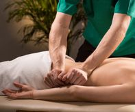 Close-up of physical therapist doing medical massage-1